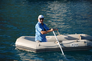 Anthony demonstrates the art of rowing a rubber dinghy minus its seat!